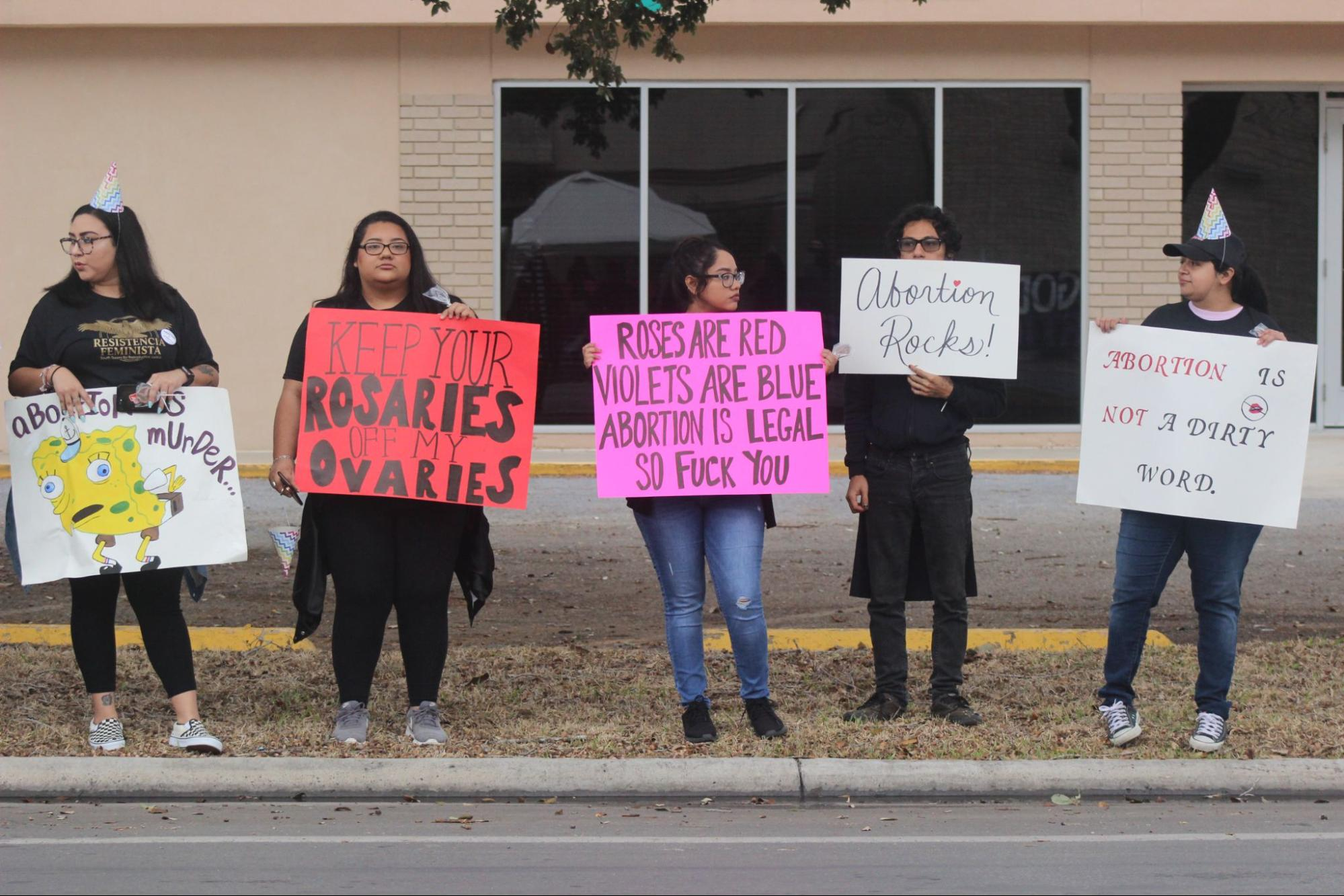 We're Still Here March 2019 reproductive justice supporters holding signs showing solidarity for abortion and Whole Women's Health Clinic in McAllen. 📷 by Freddy Jimenez.